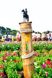 The equestrian statue of King Chulalongkorn Rama V at the Bamb. Oo lamp. In Colorful flowers garden and Traditional Thai Costumes in Bangkok Thailand royalty free stock image