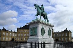 Equestrian statue of King Frederik V mounted on a marble plinth at Amalienborg. Copenhagen, Denmark royalty free stock photography