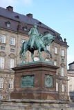 The equestrian statue of King Frederik VII in front of the Christiansborg Palace in Copenhagen, Denmark.  Royalty Free Stock Photography