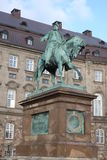 The equestrian statue of King Frederik VII in front of the Christiansborg Palace in Copenhagen, Denmark.  Stock Images