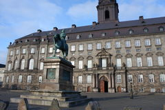The equestrian statue of King Frederik VII in front of the Christiansborg Palace in Copenhagen, Denmark.  Royalty Free Stock Photos