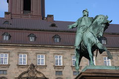 The equestrian statue of King Frederik VII in front of the Christiansborg Palace in Copenhagen, Denmark.  Stock Image