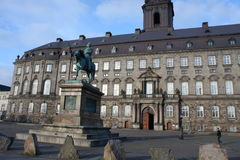 The equestrian statue of King Frederik VII in front of the Christiansborg Palace in Copenhagen, Denmark.  Royalty Free Stock Images