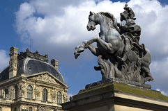 Equestrian statue of king Louis XIV in courtyard of the Louvre museum Stock Images