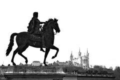 Equestrian statue of Louis XIV and the Basilica of Notre Dame de Fourviere Stock Photos