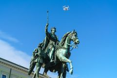 Equestrian statue of Ludwig I of Bavaria 1862 and flying drone. Equestrian statue of Ludwig I of Bavaria 1862 and flying air drone quadrocopter, Munich, Germany Stock Image
