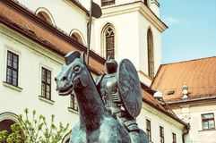 Equestrian statue of margrave Jobst of Luxembourg, Brno, yellow. Equestrian statue of margrave Jobst of Luxembourg and Church of St. Thomas, Brno, Moravia, Czech Royalty Free Stock Image