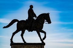 Equestrian monument on pedestal in backlight Royalty Free Stock Photography