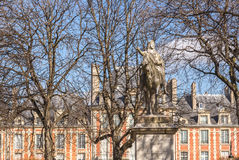 Equestrian statue at the place des Vosges in Paris Stock Photo