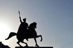Equestrian statue silhouetted against the sun Stock Photography