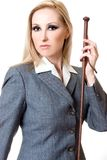Equestrian style. Woman wearing grey equestrian jacket and holding brown leather plaited whip Stock Image