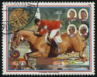 Equestrian team jumping at Summer Olympics at Seoul. RUSSIA KALININGRAD, 19 APRIL 2017: stamp printed by Paraguay, shows equestrian team jumping at Summer Stock Photography