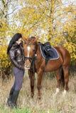 Equestrian z jej koniem Zdjęcie Royalty Free