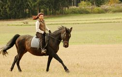 Equestrienne. Woman rides on a horse Stock Photography