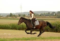 Equestrienne  goes  like blazes. Royalty Free Stock Photos