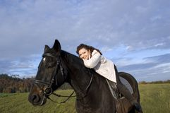 Equestrienne and horse. Stock Photo