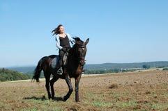 Equestrienne und Pferd. Lizenzfreies Stockfoto