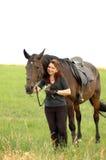 Equestrienne und Pferd. Stockbild