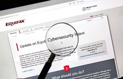 Equifax Canada home page. MONTREAL, CANADA - SEPTEMBER, 25 : Equifax Canada home page with information about cybersecurity incident under magnifying glass stock images