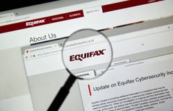 Equifax Canada home page. MONTREAL, CANADA - SEPTEMBER, 25 : Equifax Canada home page with information about cybersecurity incident under magnifying glass Stock Photography