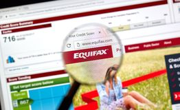 Equifax official site and logo under magnifying glass stock photos