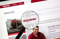 Equifax official site and logo under magnifying glass stock photo