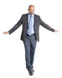 Equilíbrio de passeio do homem de negócios indiano Fotografia de Stock Royalty Free