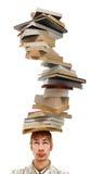 Equilibratura della pila di libri sulla testa Fotografia Stock