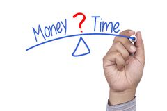 Equilibrio fra tempo e soldi Fotografia Stock