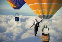 Equilibrist businessman stock photos