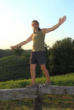 Equilibrist over vineyards Stock Image