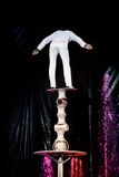 Equilibrist skillfully balances in circus Royalty Free Stock Photo