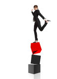 Equilibrium. Metaphor - Young attractive businesswoman in balance over three cubes Royalty Free Stock Photo
