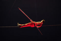 Equilibrium act. Artist from Orlando circus in equilibrium act on rope, Bucharest, Romania Royalty Free Stock Images