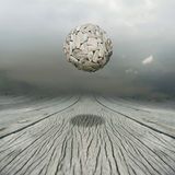Equilibrium. Artistic metaphysical background representing a ball sculpture floating in the air above a wooden floor with the sky on the background royalty free illustration