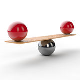 Equilibrium and balance on a seesaw. Equilibrium and balance on with two red balls on a seesaw Royalty Free Stock Photo