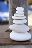 Equilibrium. Perfectly balanced white rocks on a table royalty free stock photo