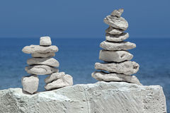Equilibrium of the pyramid stones. Pyramid made ​ of stone symbolizes the stable equilibrium Royalty Free Stock Images
