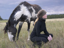EquineDreams. Girl and horse in landscape dreamy lighting Royalty Free Stock Photography