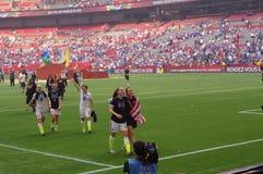 A equipa de futebol das mulheres dos E.U. comemora o vencimento do campeonato do mundo 2015 de FIFA Imagens de Stock