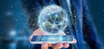 Equipaggi il collegamento della tenuta intorno ad un renderin del globo 3d del mondo Immagine Stock