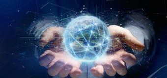 Equipaggi il collegamento della tenuta intorno ad un renderin del globo 3d del mondo Fotografia Stock Libera da Diritti