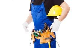 Equipaggi il costruttore con l'insieme degli strumenti della costruzione, isolato Fotografia Stock