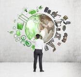 Equipaggi il pensiero all'ambiente, alla produzione di petrolio e al ico ecoenergy Immagine Stock