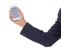 Equipaggi il telefono cellulare della tenuta della mano isolato su fondo bianco Fotografia Stock