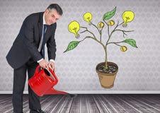 Equipaggi l'annaffiatoio della tenuta ed il disegno dei soldi e dei grafici di idea sui rami della pianta sulla parete Fotografia Stock Libera da Diritti