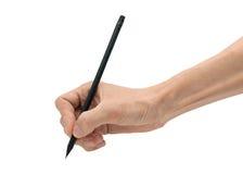 Equipaggi la mano con la matita nera su un fondo bianco Fotografie Stock