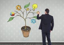 Equipaggi la penna di tenuta ed il disegno dei grafici dell'attività sui rami della pianta sulla parete Fotografia Stock
