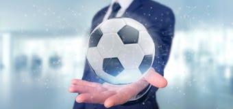 Equipaggi la tenuta del renderin della palla e del collegamento 3d di calcio Fotografia Stock