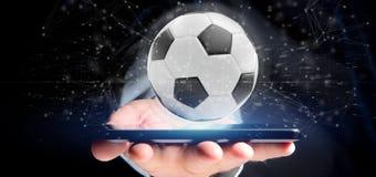 Equipaggi la tenuta del renderin della palla e del collegamento 3d di calcio Immagini Stock Libere da Diritti